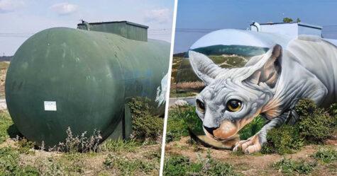 Un artiste de rue peint une illusion bluffante d'un chat sphynx sur un vieux réservoir d'essence