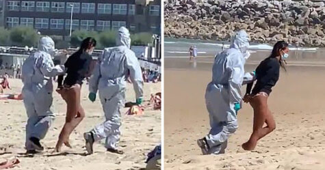 Une surfeuse infectée par le coronavirus est traînée hors de la plage par des agents vêtus de combinaisons Hazmat